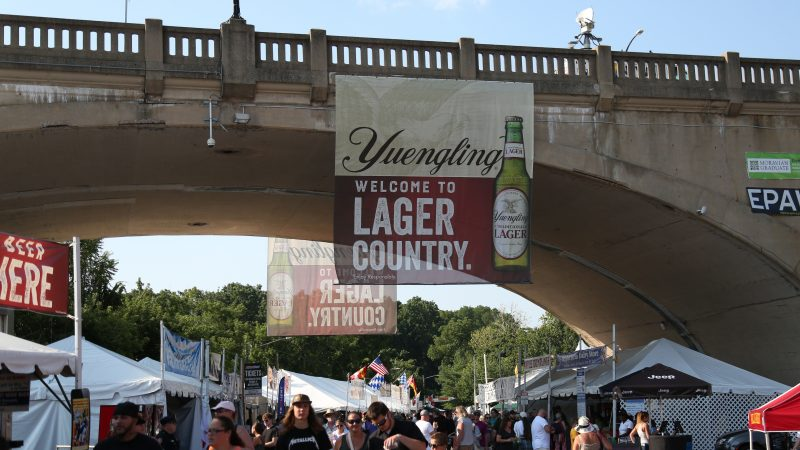 """A Yuengling banner reading """"Welcome to Lager Country"""" hanging above Musikfest grounds"""