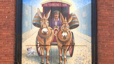 A close up of the completed mural showing a horse-drawn carriage